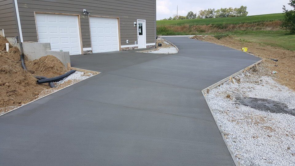 Freshly poured cement driveway and additional parking pad